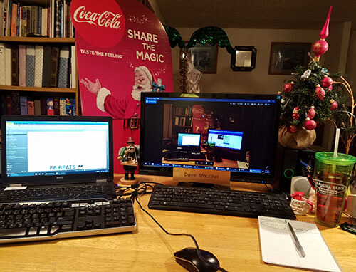 A work from home office that has Christmas decorations all over the room the desk is in
