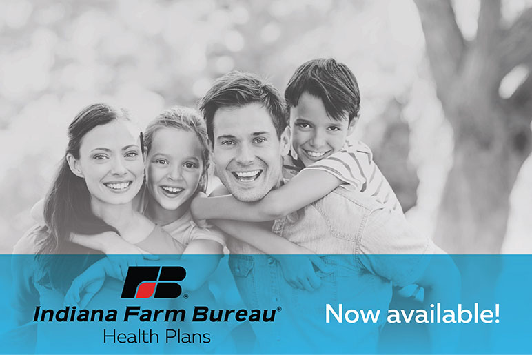 Family of four with their children on their backs smiling with a logo of Indiana Farm Bureau in front of them
