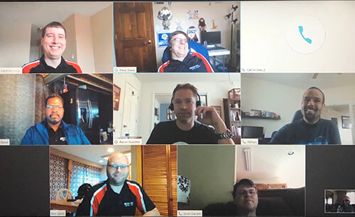 Server Support Team Meeting on Zoom with multiple employees in their employee shirts